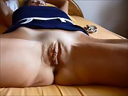 FRENCH MILF SHOWS HER TOTALLY SHAVED PUSSY SPREADING HER THIGHS ON BED