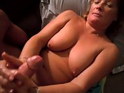 Mature wife using both her hands to stroke the cock squeezing it hard