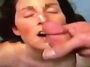 Slut wife working a cock and licking balls for cum on her face 2
